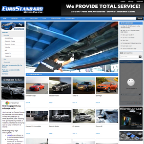 A sample website for a cars and auto parts business with a man in black shirt and white gloves fixing the bottom of a car